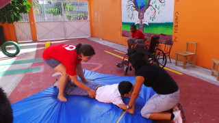 Nadia helping with the movement therapy at the Special Needs School