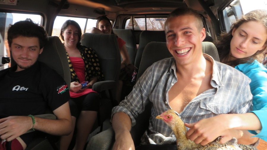 One team accidentally acquires a chicken during a visit to a Masai Village...