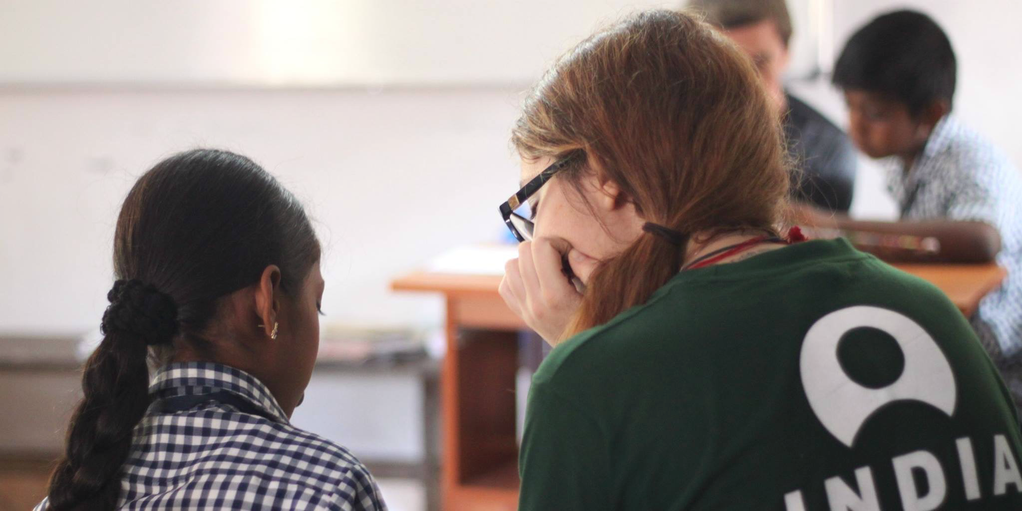 A GVI volunteer working with children on a program in India. Read how to list volunteer experience on your CV.
