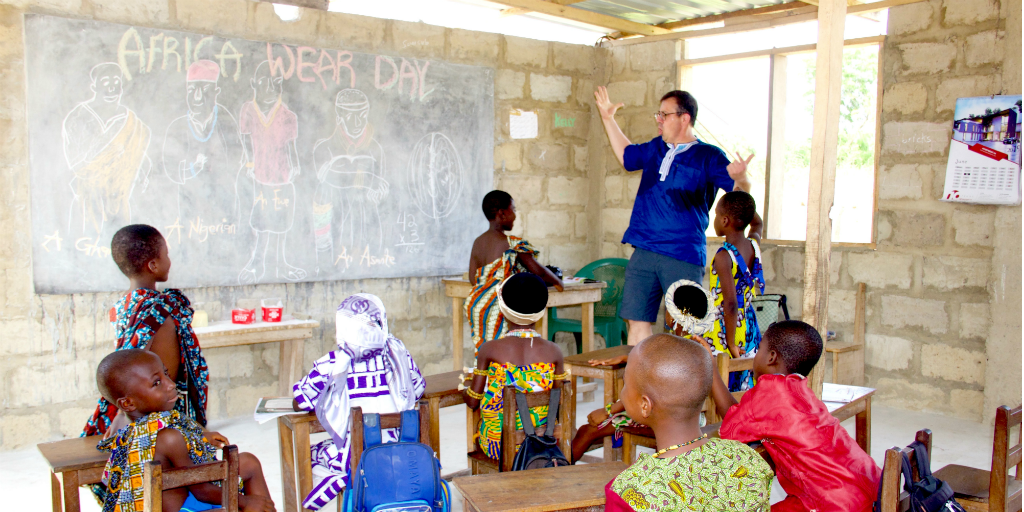 A volunteer teaching a class of children in Ghana.