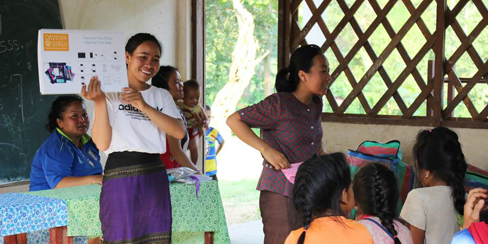 A GVI community liason takes part in leadership development while delivering the menstrual health program in rural Laos.