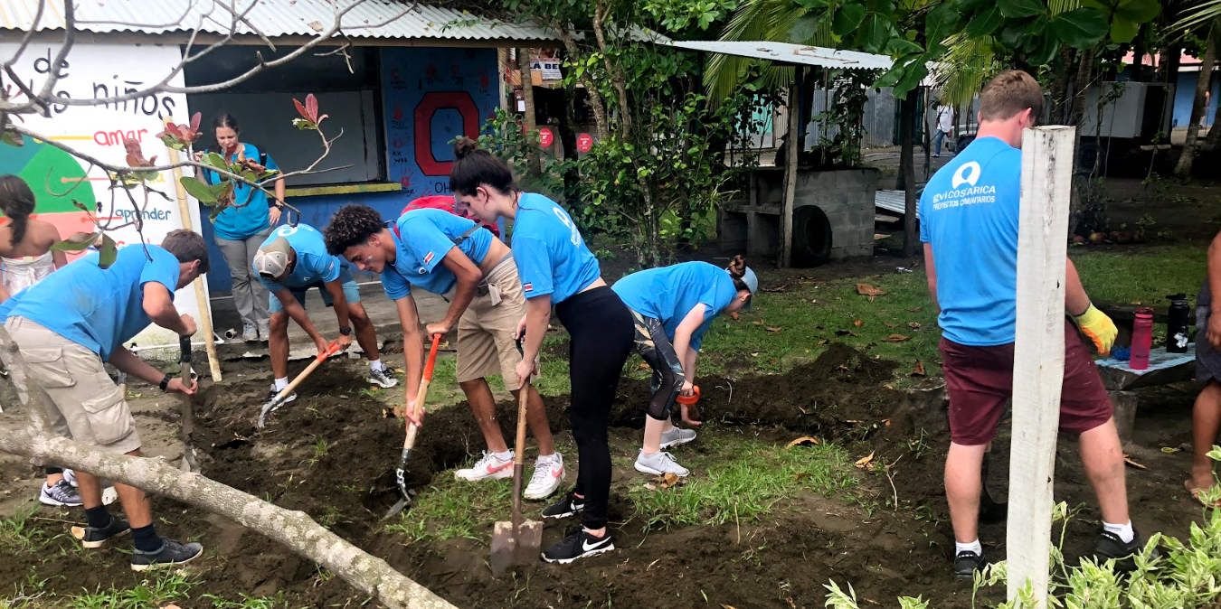 Participants help to prepare a garden while on a gap year before college.