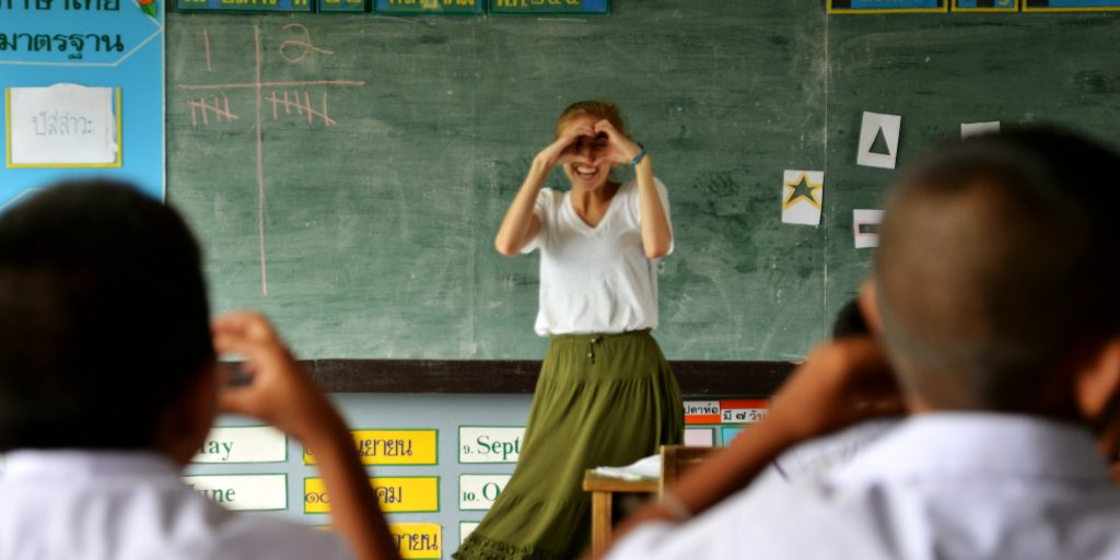 A teaching intern in Thailand teaches students about shapes