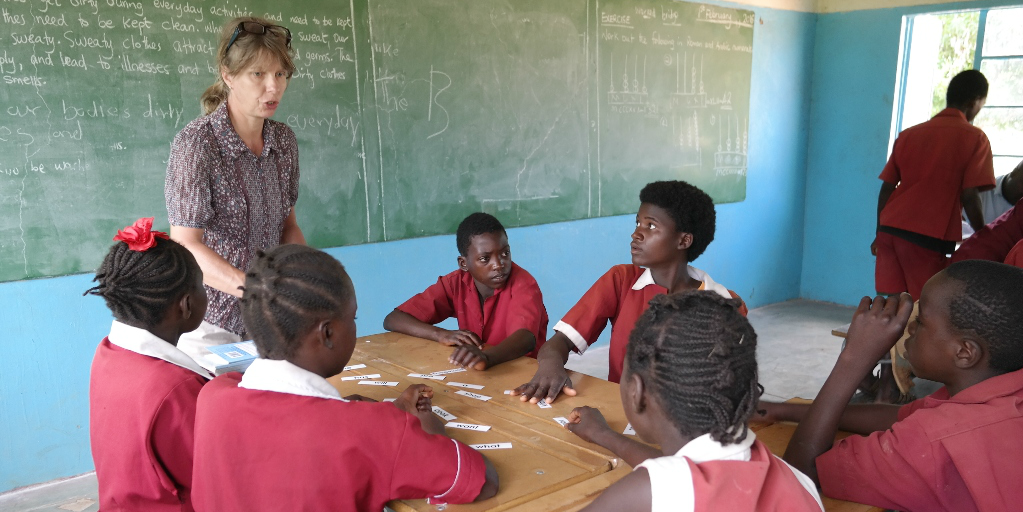 A participant leads a lesson as a volunteer in Zambia.