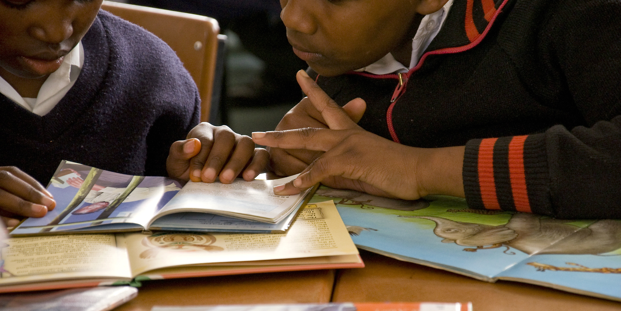 Learners focus on their reading. Volunteer opportunities in South Africa include initiatives to support learning.