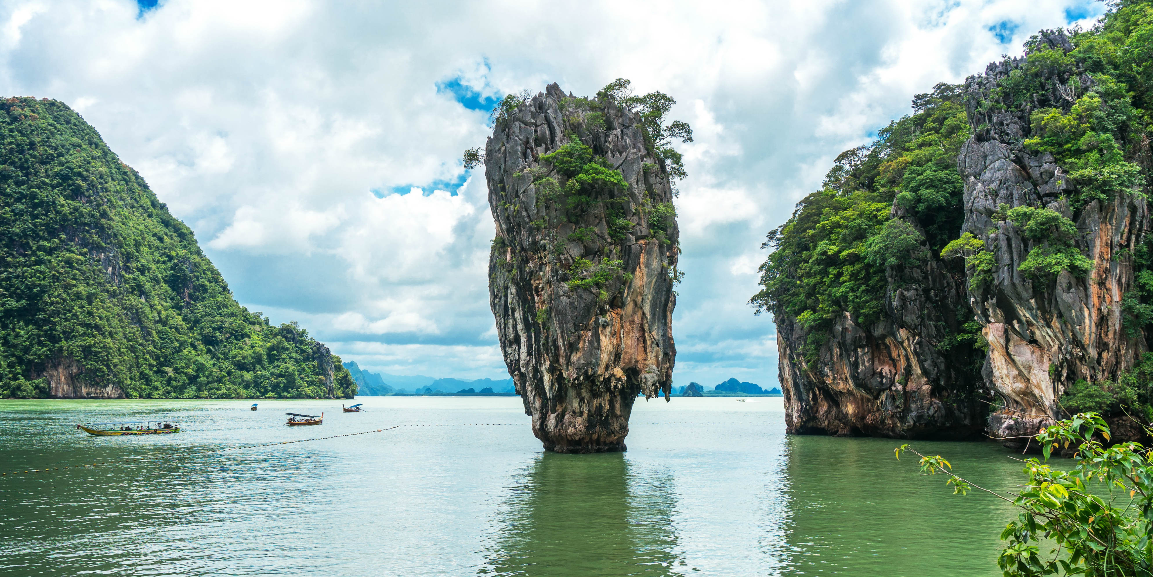 Boat trips around Phang Nga bay, Thailand, include amazing views and the James Bond Island shown here.