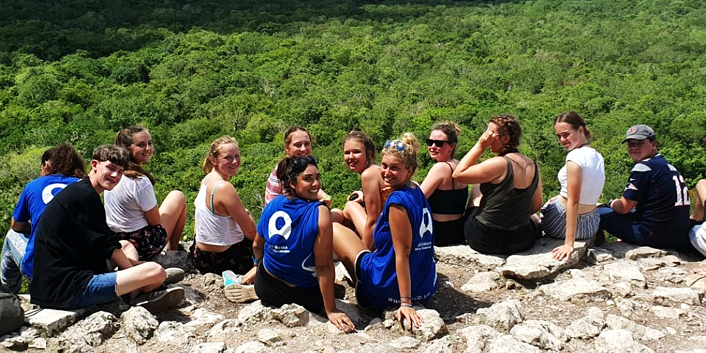 GVI volunteers on top of the Coba pyramid