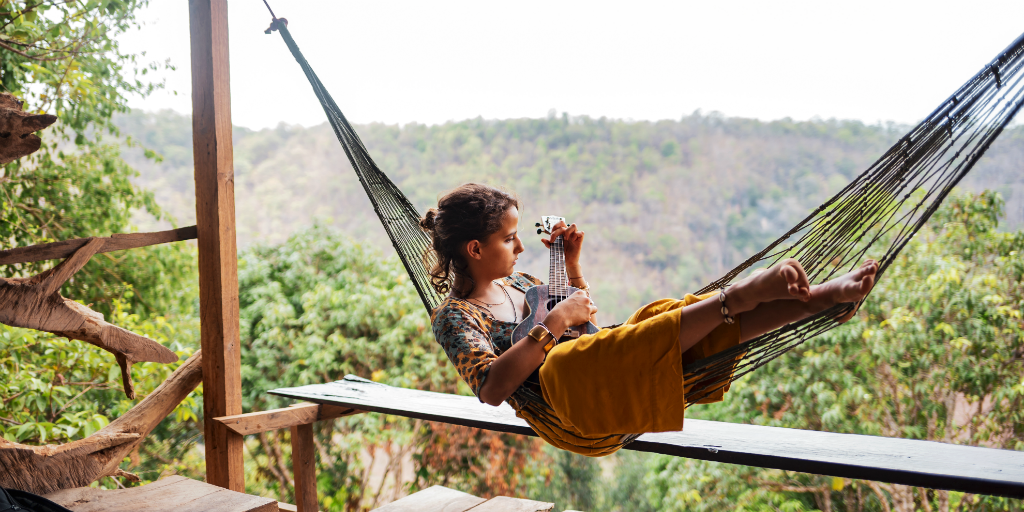 Girl relaxing on a hammock in Thailand