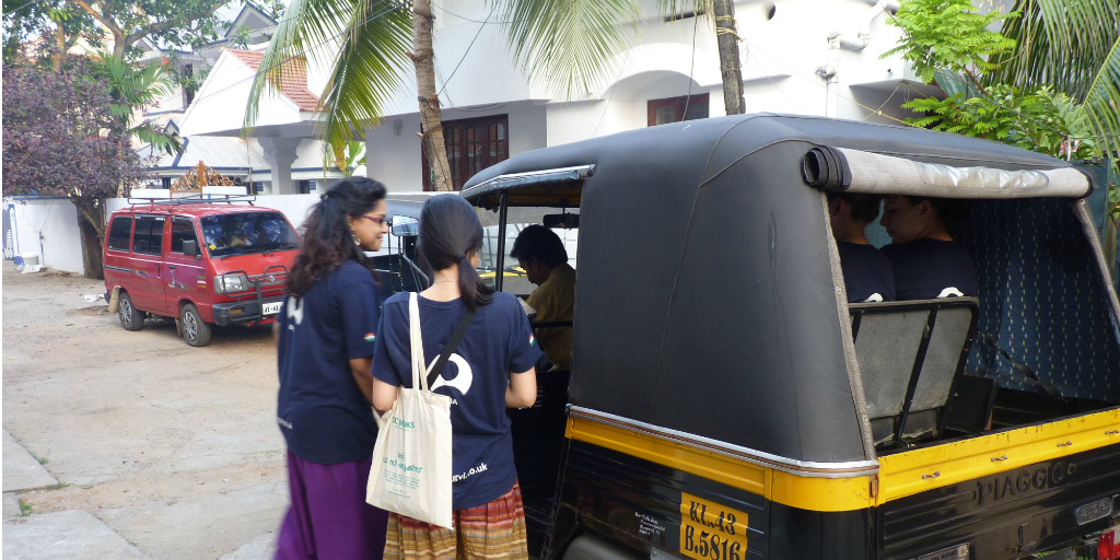 volunteers getting into a tuk-tuk in India