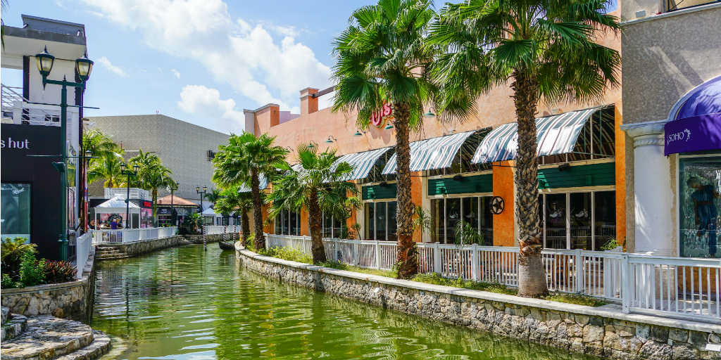 Shops surrounding a canal in Cancun