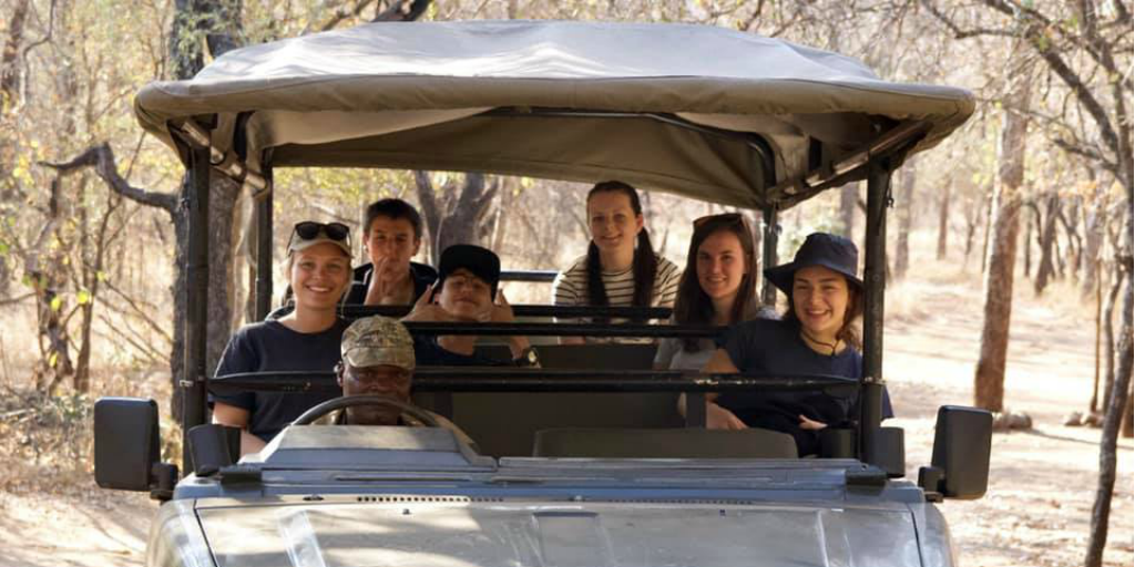 GVI under-18 volunteers in a safari vehicle in South Africa