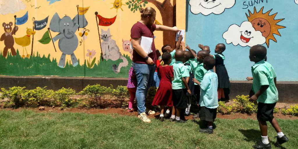 A volunteer teaching students about the environment in Kilimanjaro.