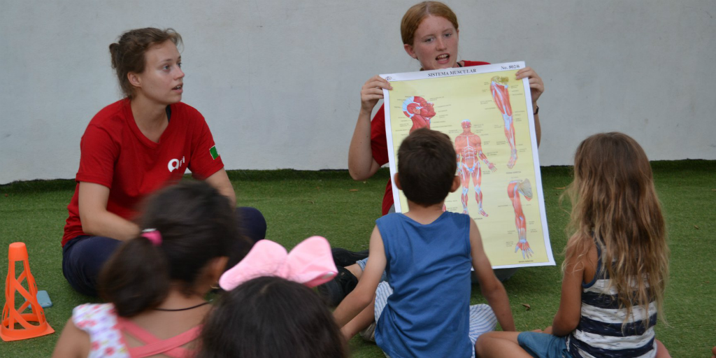 Volunteers teaching good public health practices and preventative healthcare