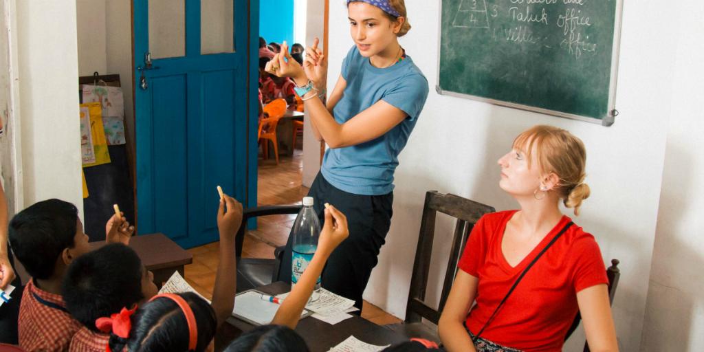 a volunteer in india teaching children
