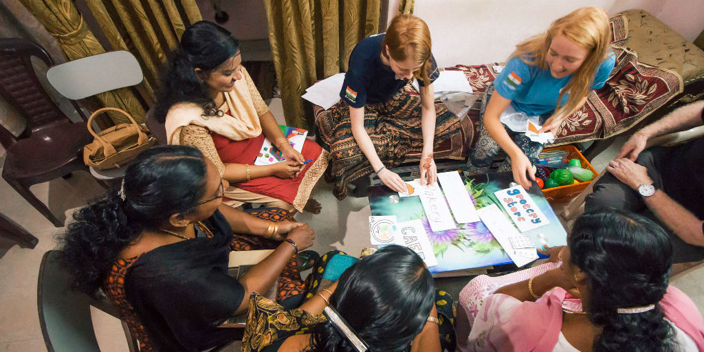 A group of women work on their English language skills as part of a women's empowerment program.