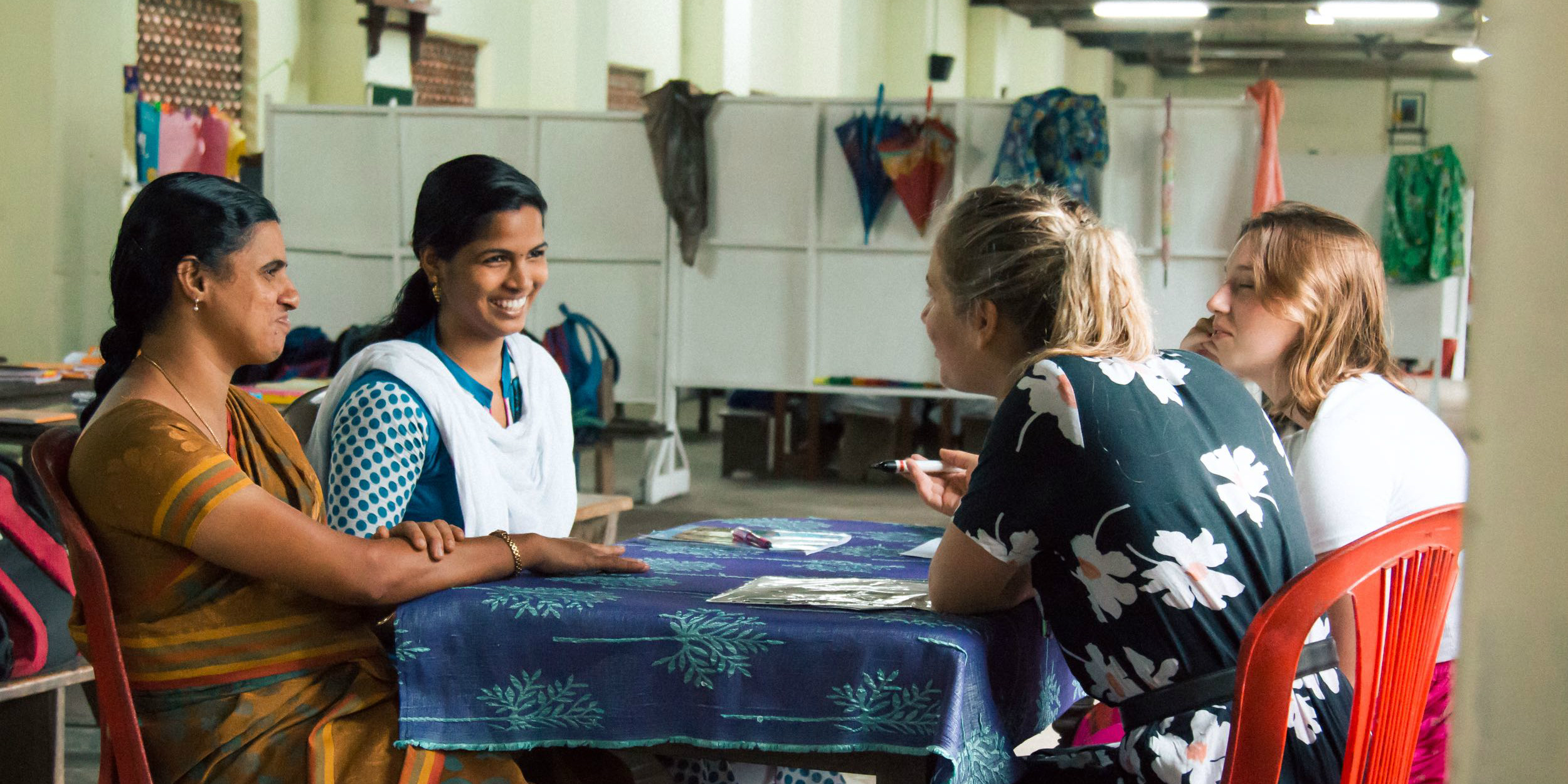 Women work through educational content as part of women empowerment in India efforts.